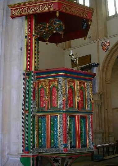 The brightly painted pulpit of the Church